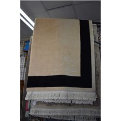 """Oriental influenced sculpted wool carpet with light taupe and edged with black banding 88"""" X 116"""""""