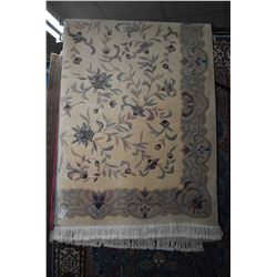 """Sculpted wool area carpet with overall floral design and stylized border 100"""" X 140"""""""