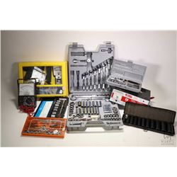 A selection of hand tools including multi meter, test and tune up set, socket sets, tap & die set an