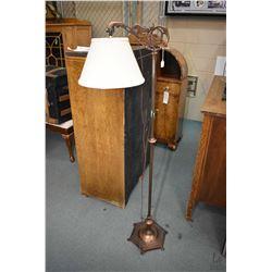 Antique bridge lamp with cast nouveau influenced base and figural bridge arm and bronze copper patin