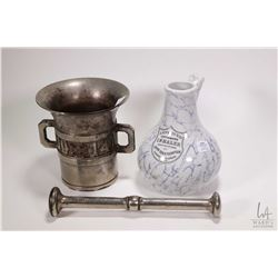 """Antique nickel plated double handled cast mortar dated 1914 and 1916 6 3/4"""" in height with pestle pl"""