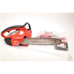 Homelite XL-2 Chainsaw, ran at time of cataloguing, new in package replacement chain and a sharpener