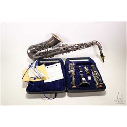 Vintage Yamaha clarinet YCL 24 in case plus a very tired and dirty tiny saxophone made by Frank Holt