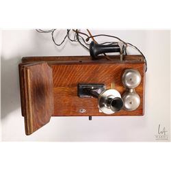 Quarter cut oak cased Northern Electric wall phone, appears complete except battery
