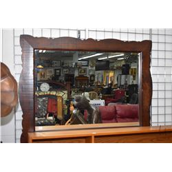 "Bevelled wall mirror in rust style wooden frame, overall dimensions 48"" X 34"""