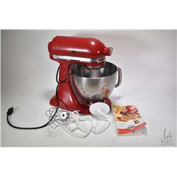 Kitchenaid Artisan mixer with dough bowl, dough hook, wire whip, and a flat beater includes instruct