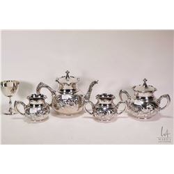 Silver-plate tea service including teapot cream and sugar bowl plus small lidded biscuit and a silve
