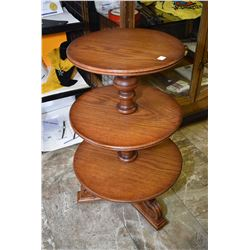 Three tier mid 20th century oak butler on metal castors