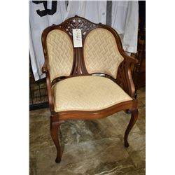 Mid 20th century walnut framed upholstered arm chair with fretwork back and sides