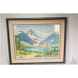 """Framed watercolour of a water mountain scene signed by artist Anne Carmichael '73, 15"""" X 19"""""""
