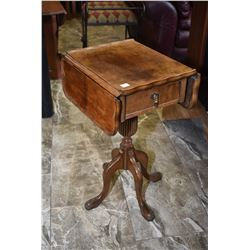 Mid 20th century matched grain walnut center pedestal drop leaf side table with single drawer