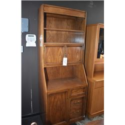 Semi contemporary wall unit with assorted door and drawer storage and adjustable shelf made by Sklar