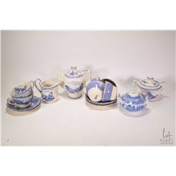 Royal Doulton blue and white tea set including small teapot, cream and lidded sugar bowl, six cups a