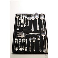 Assortment of silverplate serving pieces including meat forks, serving spoons, sugar tongs, twelve c
