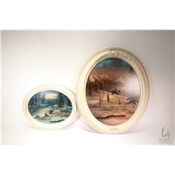 Three framed prints including two oval framed wildlife prints, wolves and a cowboy and a framed prin