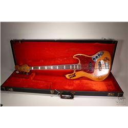 "Modified 1973 Fender Jazz bass guitar, hand signed by Steve Cropper, Mike Watt and Donald ""Duck"" Dun"