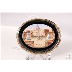 Antique rolled gold and micro mosaic brooch featuring St. Peter's Square in Vatican City. Circa 1860