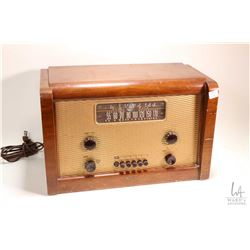 Wood cased table top Marconi Model 238 radio, working at time of cataloguing. Note: No Shipping. Loc