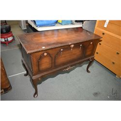 Mid 20th century cedar lined walnut chest on tall cabriole supports made by Honderich Furniture Co.