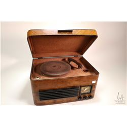 Vintage Northern Electric table top radio/ record player Model 5004, note radio is working at time o