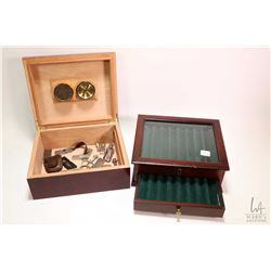 Thompson & Co. cigar humidor containing a selection of cigar cutters plus a cigar storage / display