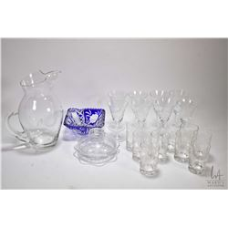 Selection of cornflower etched crystal including pitcher with ten glasses, eight claret glasses, cov