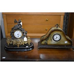 Antique cast figural clock on wooden plinth and modern mantle clock with applied map decoration, bot