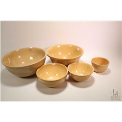 Five graduated sized stoneware bowls, mostly Medalta Potteries. Note: No Shipping. Local Pickup Only