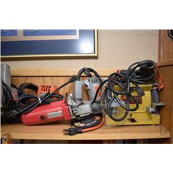 Shelf lot of power tools including bench grinder, electric chainsaw, circular saw, angle grinders et