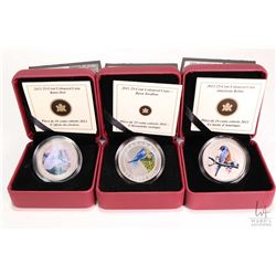 Three Royal Canadian Mint cased coloured coins including 2011 Barn Swallow 25 cent coin, 2013 Barn O