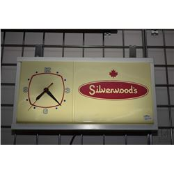 "Silverwood's promotional illuminated electric wall clock, working at time of cataloguing 10"" X 17"""