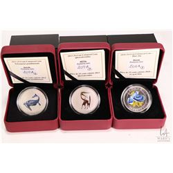 Three cased Royal Canadian Mint including two 25 cent 2013 coloured coins from the Prehistoric Creat