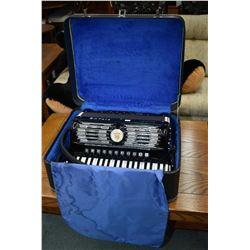 Black and white Titano Palmer-Hughes accordion in hard case
