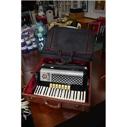 Black, cream and silver Scandalli accordion with hard and soft cases