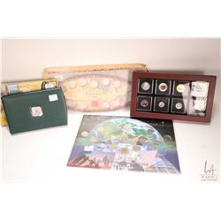 Selection of Royal Canadian Mint boxed collectors coins including 2000 Specimen set, wooden display