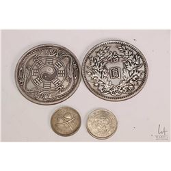 "Four white metal Oriental medallions including two 3 1/2"" and two 1 1/2"""