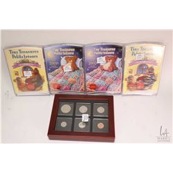 Five Royal Canadian Mint boxed coin sets including four Tiny Treasures uncirculated coin sets; two 2
