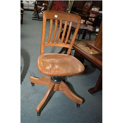 Vintage oak swivel steno chair made by Krug