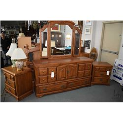 Canadian made oak bedroom suite including large mirrored dresser with assorted cupboards and drawers