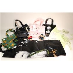 Selection of Harrod's vinyl shopping bags including three small and one large, two vinyl aprons and