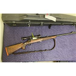 WINCHESTER MODEL 70, 375 H&H MAGNUM, BOLT ACTION, SERIAL #350083, WITH LEUPOLD SCOPE, HARD CASE AND