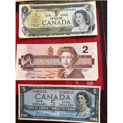 COIN COLLECTION BOOK FILLED WITH CANADIAN AND WORLD CURRENCY, CANADIAN $1, $2, $5 BILLS, COINS AND