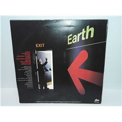 Zahn back down to earth Epic Records