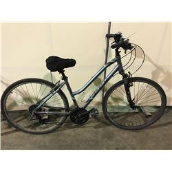 2 BIKES - BLUE CCM 24-SPEED FRONT SUSPENSION HYBRID CRUISER BIKE, RED SUPERCYCLE 18-SPEED ROAD BIKE