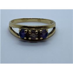 10K RING WITH MAUVE STONES