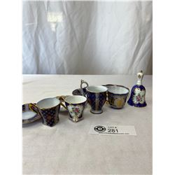 4 Mini Cups And Saucers And Bell