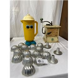 Vintage Coffee Grinder And A Happy Face Jug With Cake Decorating Molds