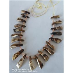 20 BUFFALO TEETH STRUNG TOGETHER WITH RAWHIDE,