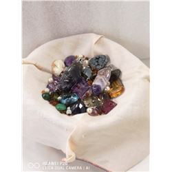 SMALL DISH CONTAINING VARIOUS GEMS TAKEN FROM