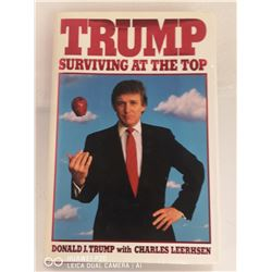 "1990 SIGNED COPY OF DONALD TRUMPS ""SURVIVING AT"